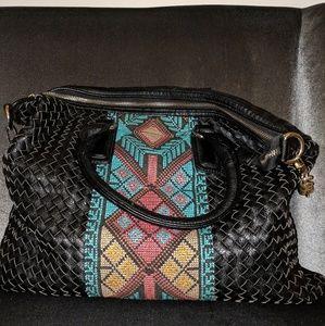 Black woven shoulder bag with embroidered design